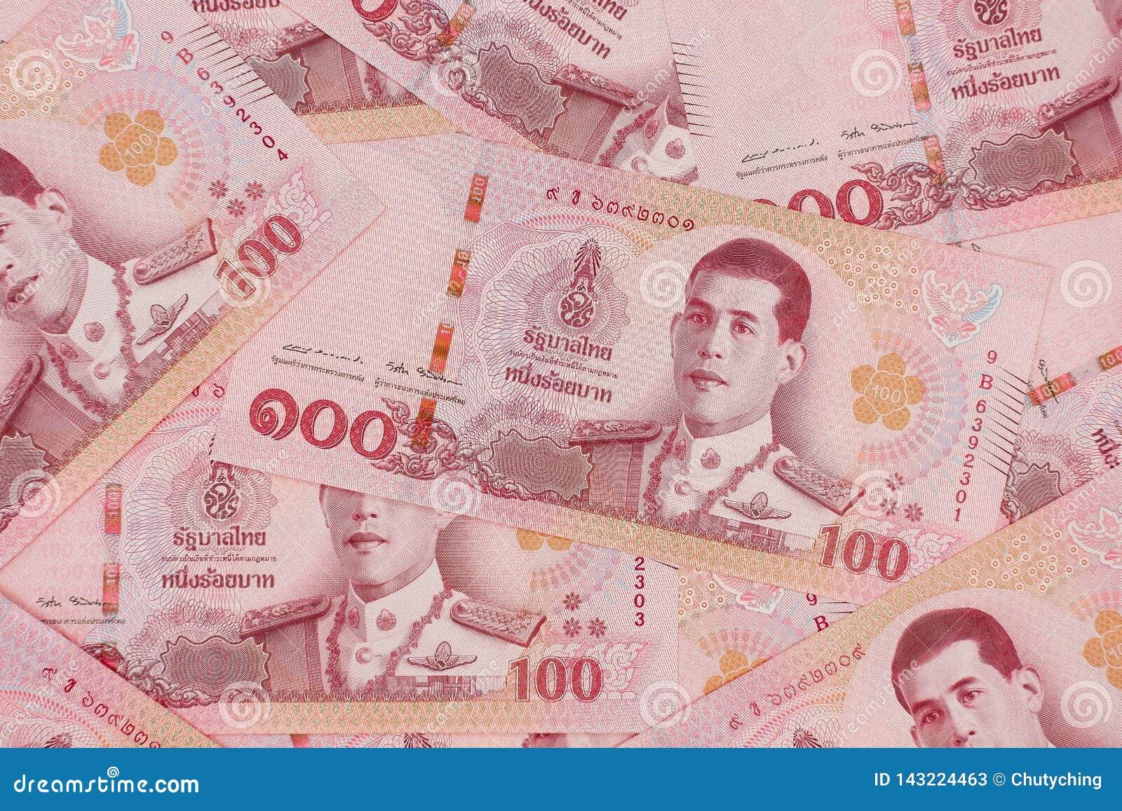 Stapel van nieuwe 100 Thaise Bahtbankbiljetten