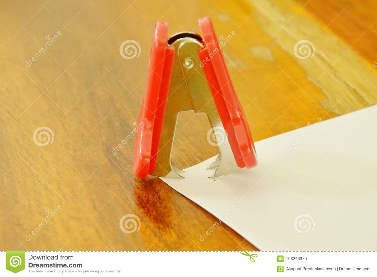 Staple Remover Pulling Wire From Paper On Wooden Table Stock Photo ...