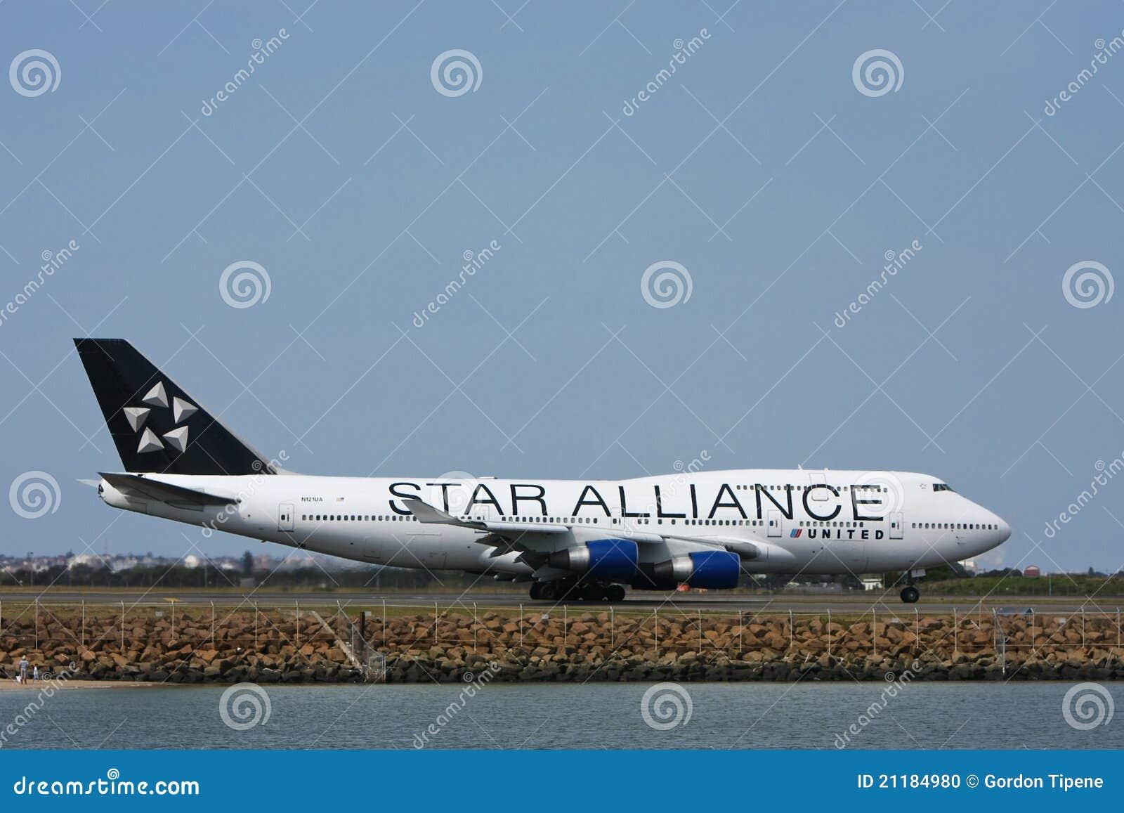 Star Alliance United Boeing 747 on runway.