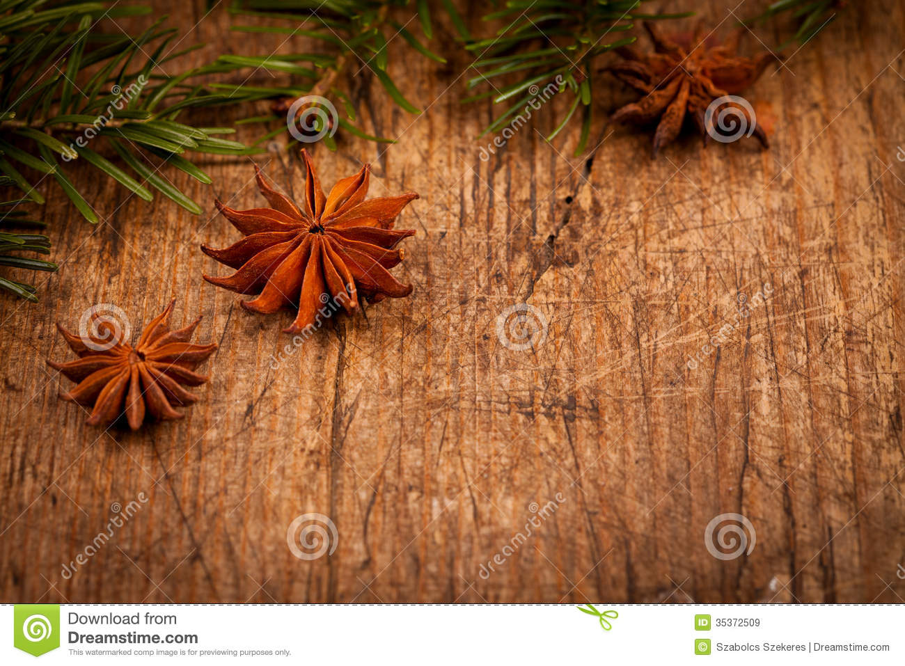 Star anise and branch on wooden background royalty free for Rustic concept
