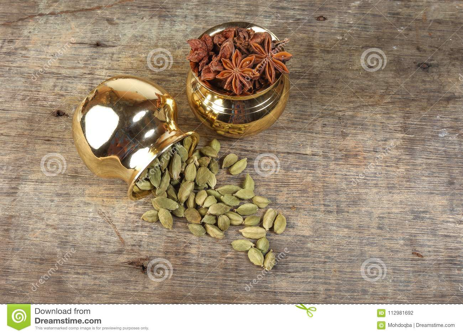 Star Anise Cardamom spice in golden metal pot