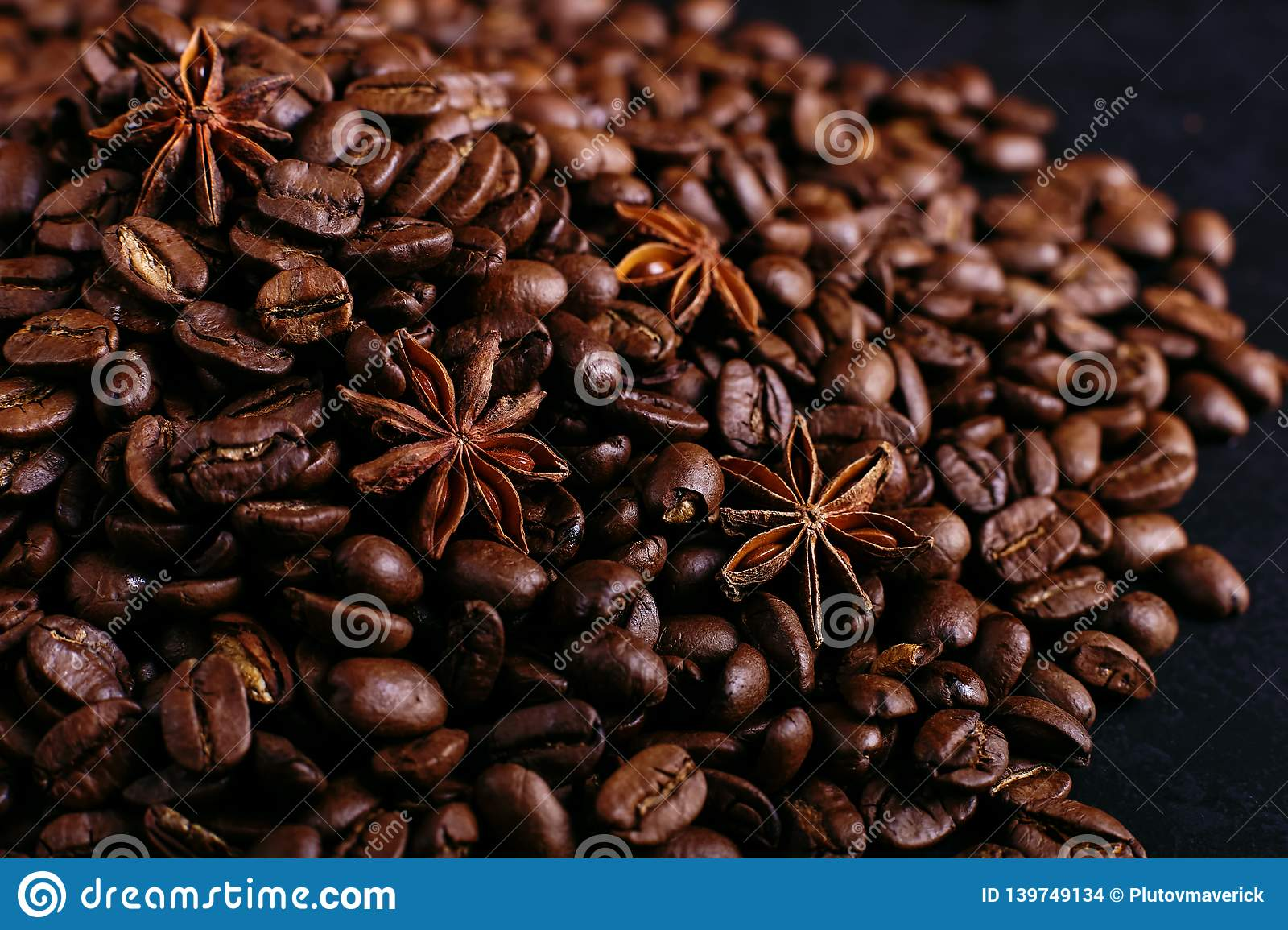 Star anise and coffee beans on the kitchen table. Fragrant spices for coffee drink, closeup background