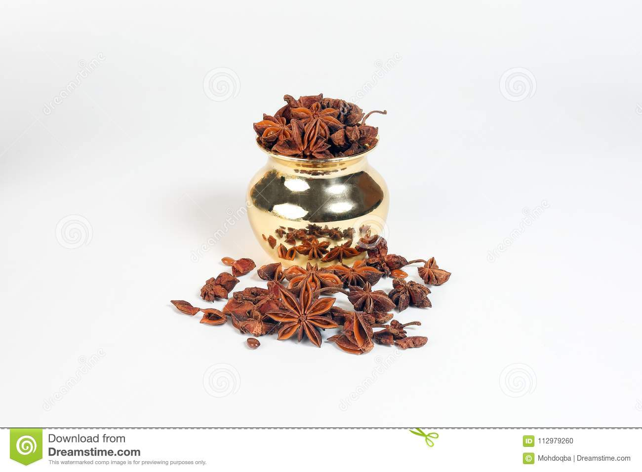 Star anise spice in shiny metal pot