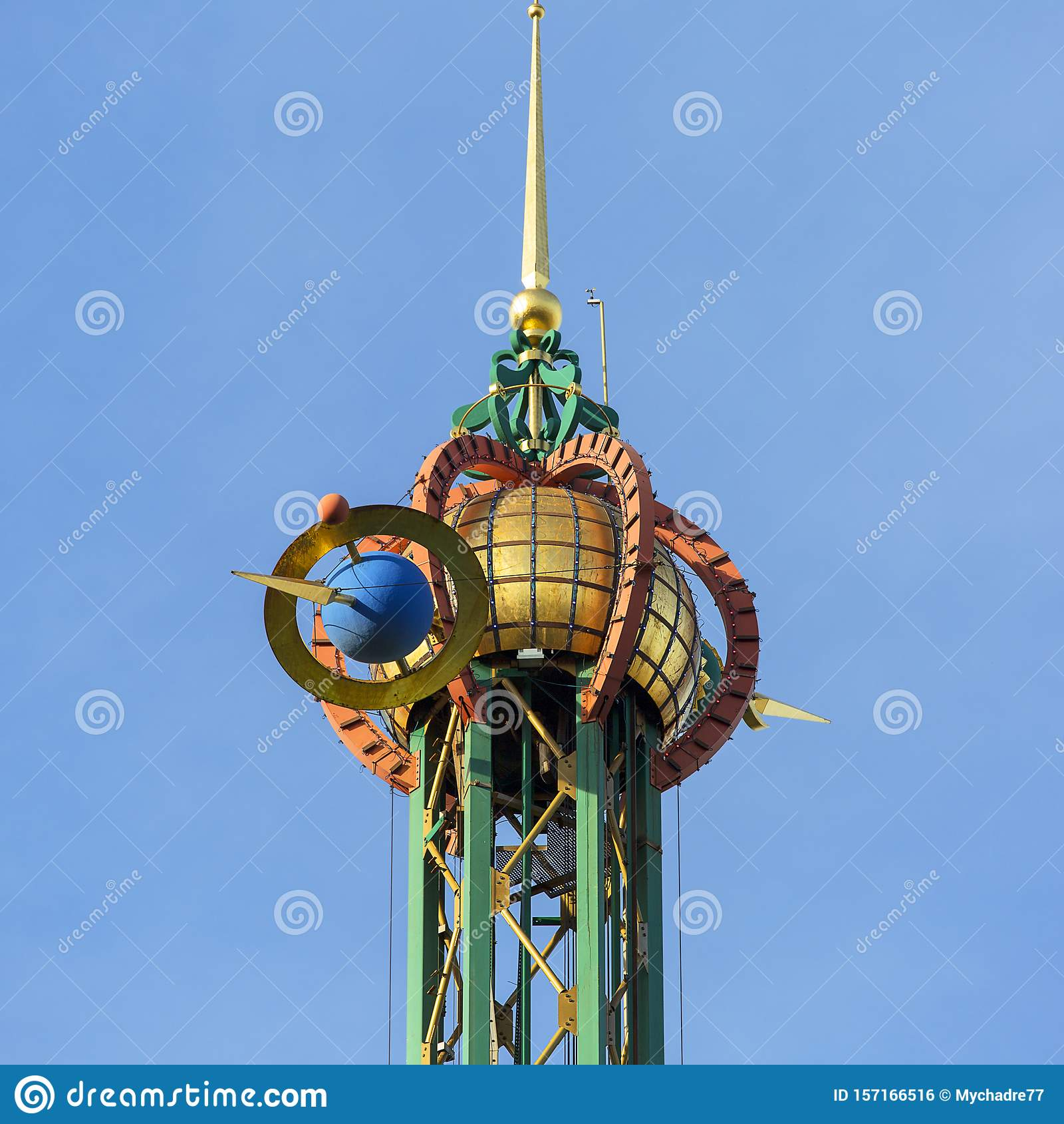 Star Flyer carousel in Amusement Park, Tivoli Gardens, view on the decorative top, Copenhagen, Denmark