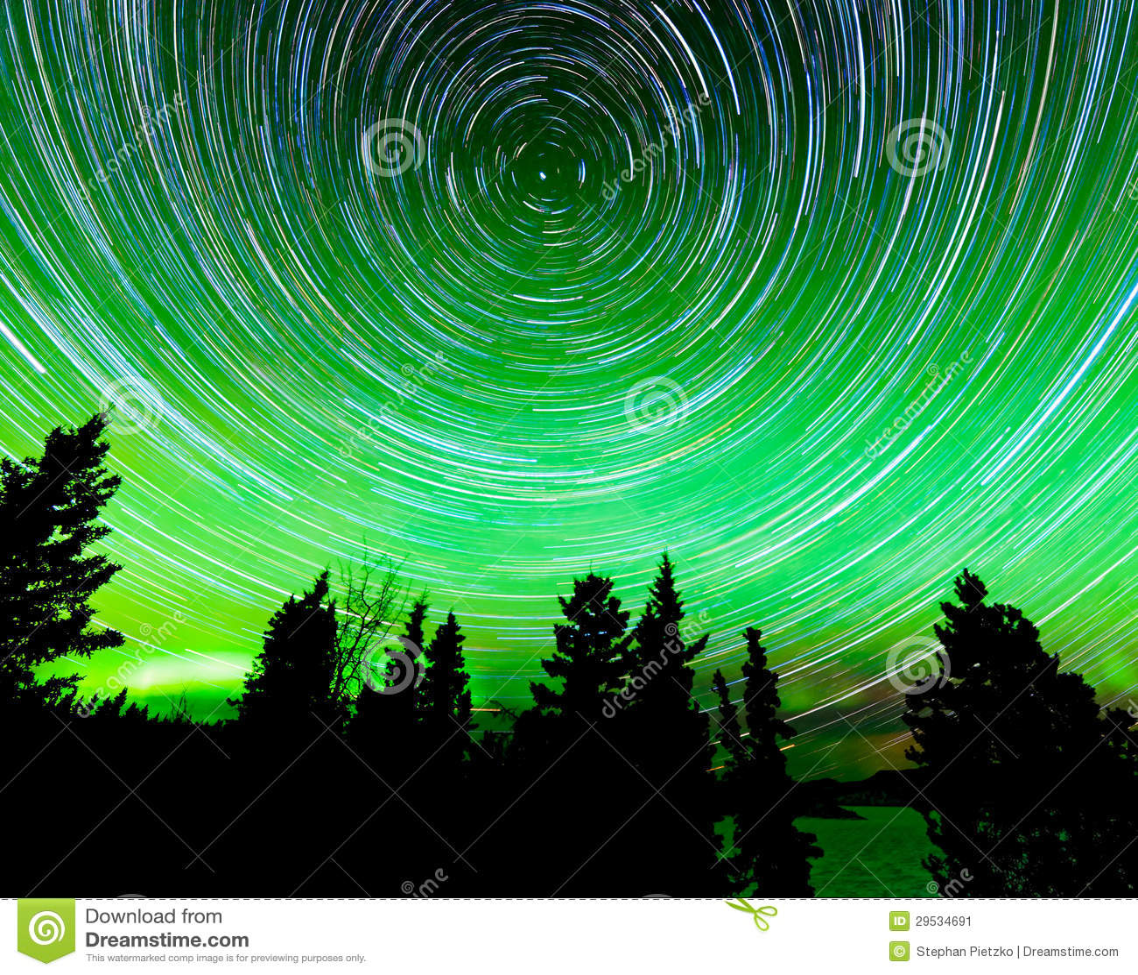 Star Trails Around Polaris And Northern Lights Stock Image