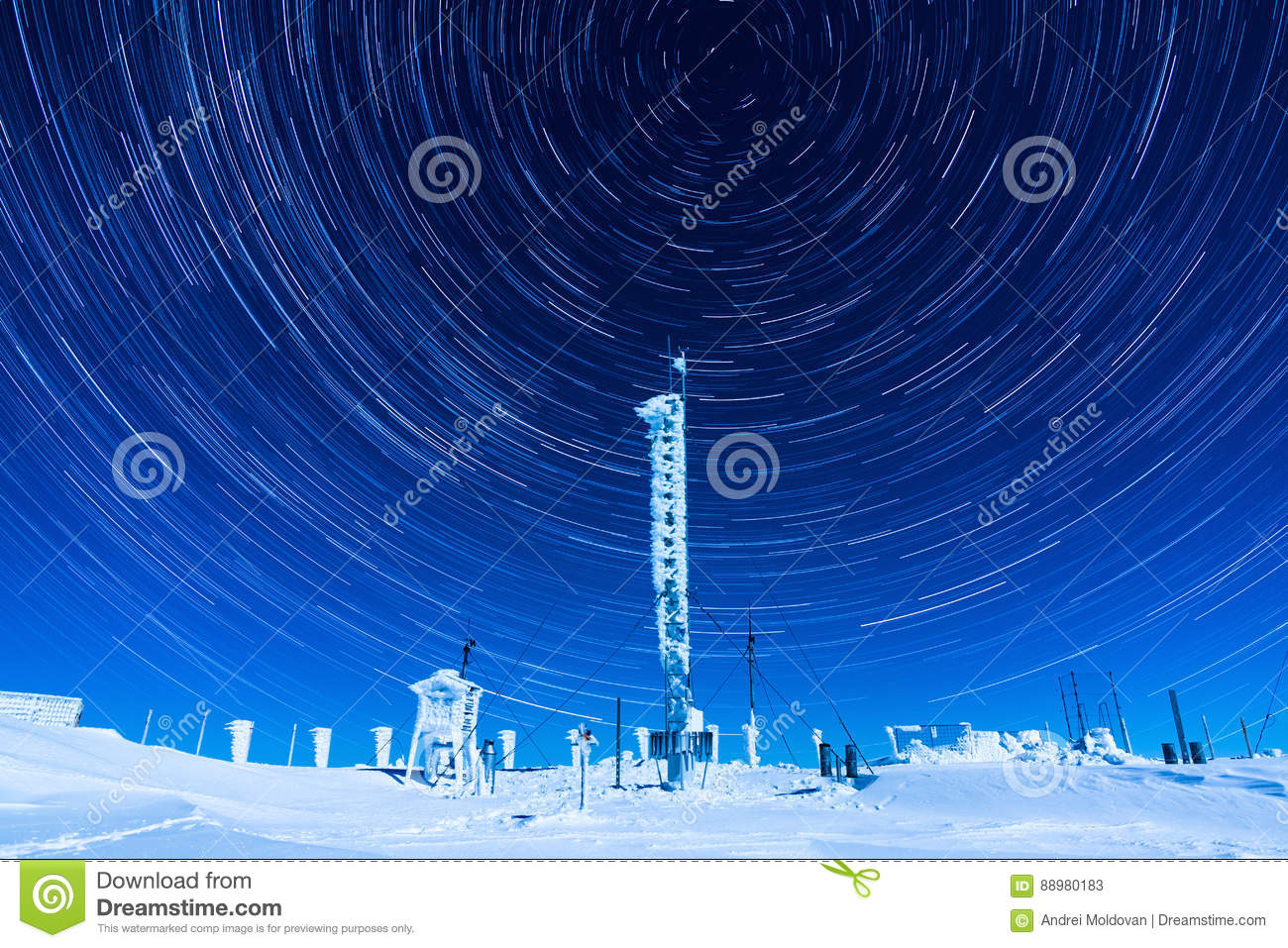 Beautiful star trails on the night sky during a clear winter night while spending time on top of a mountain