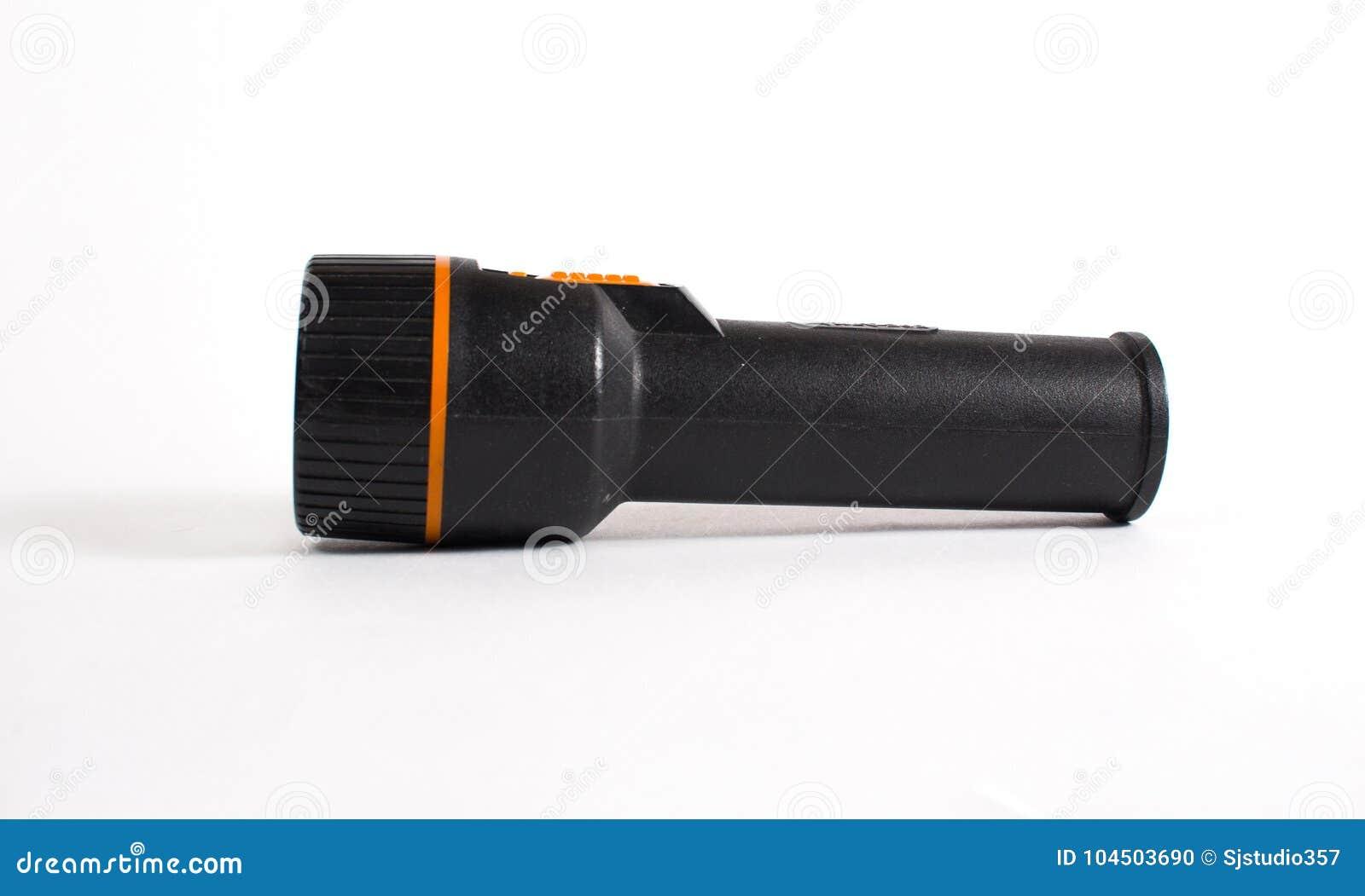 Stara czarna latarka odizolowywająca na białym tle