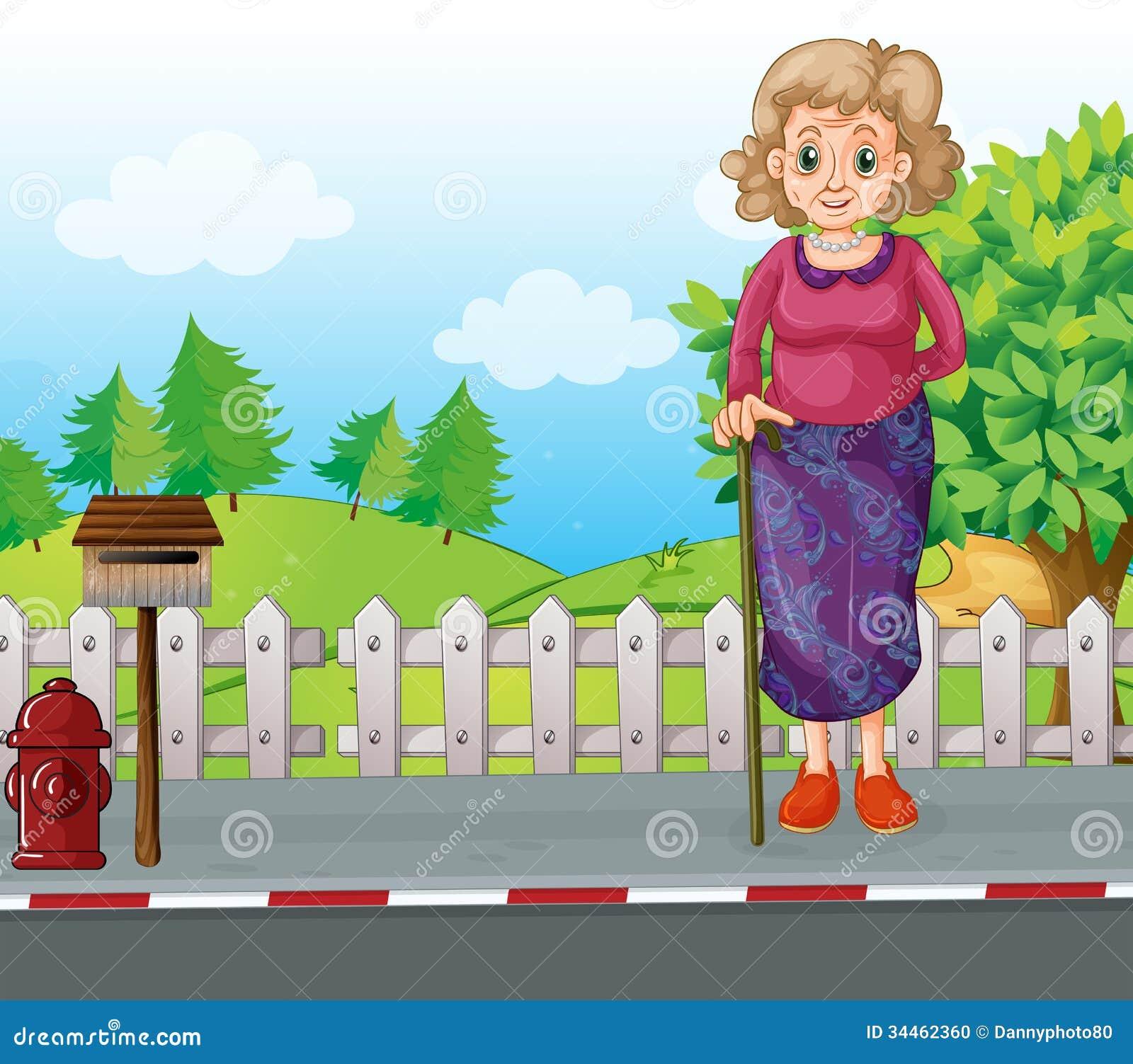 Stara kobieta z trzciny pozycją przy poboczem blisko mailb