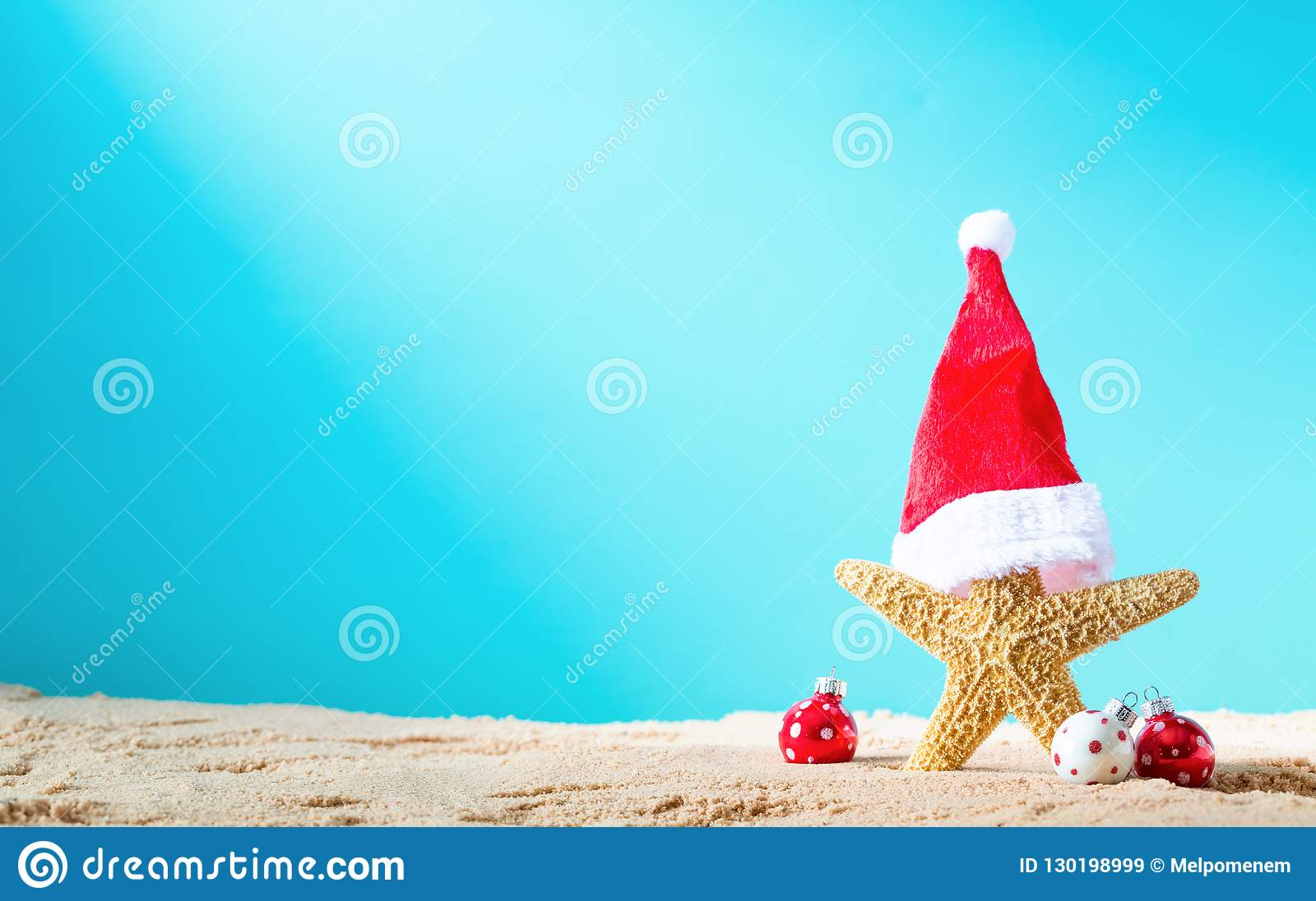 Starfish With Santa Hat On The Beach With Christmas Ornaments Stock