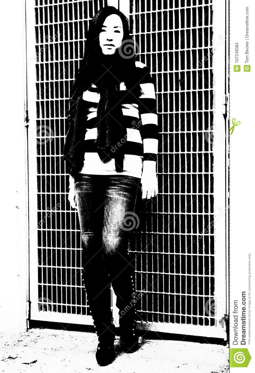 Stark contrast in photo of young woman of her horizontal striped sweater against grid background in this black and white image