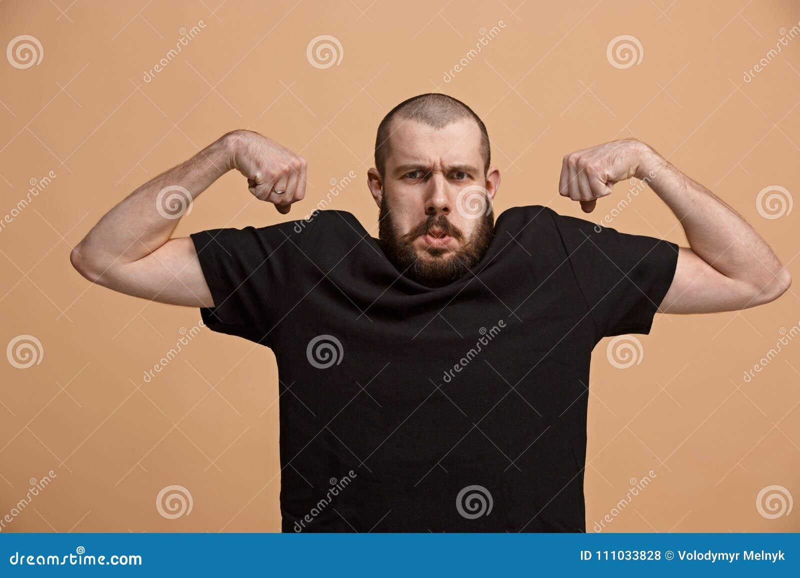 Starkt affärsmanbegrepp Affärsman som visar muskulösa händer
