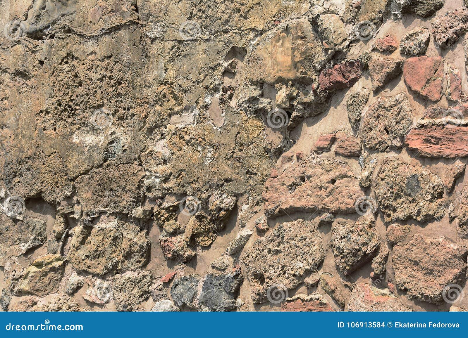 Starożytna kamienna ściana Kamieniarstwo stary brudzi kamienie i cegły Piękny tło