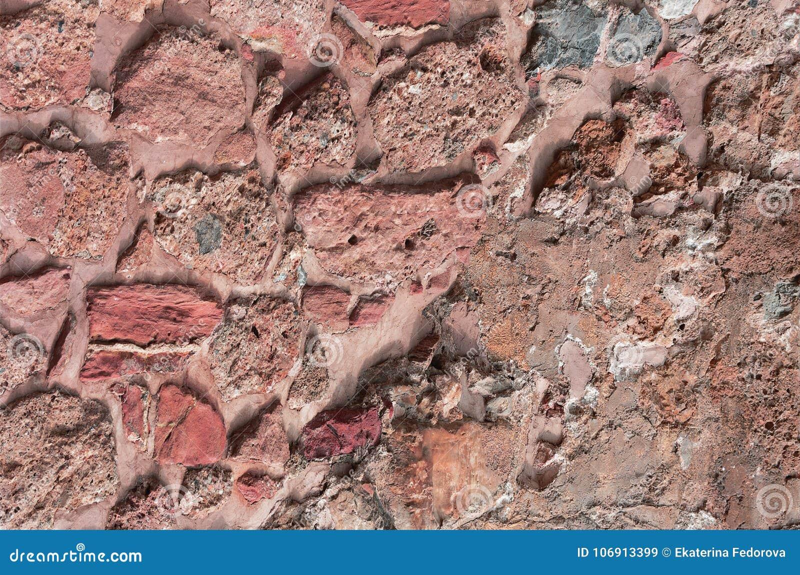 Starożytna kamienna ściana Kamieniarstwo starzy czerwień kamienie, cegły i Piękny tło