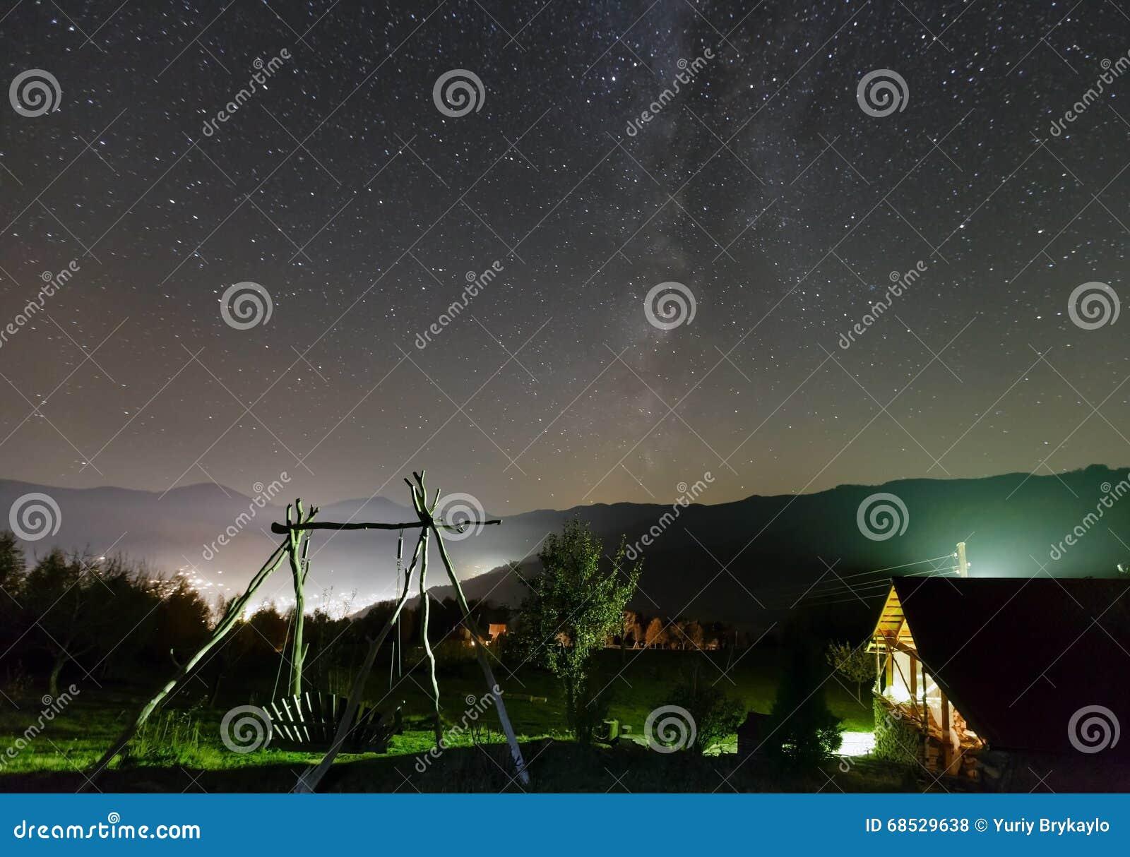 Starry Night Sky Over Mountain Village. Stock Photo ...