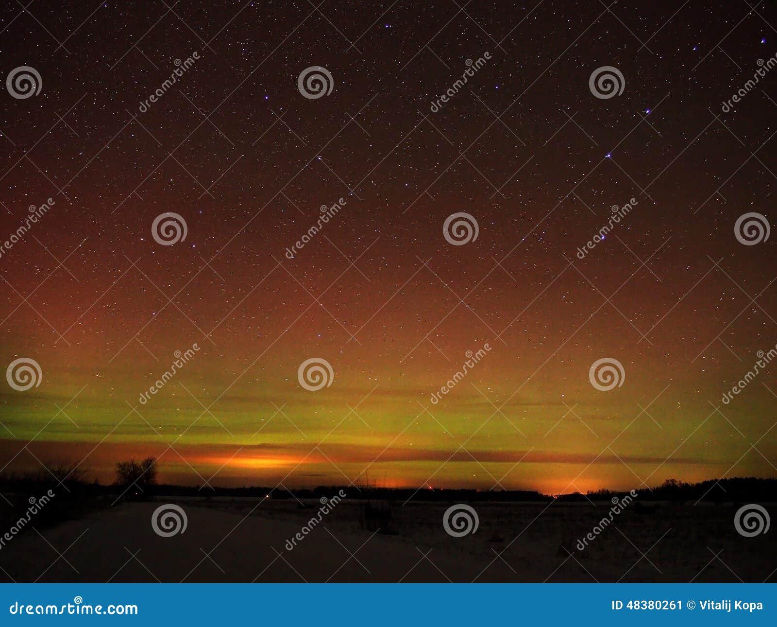 Night sky stars and aurora polar lights