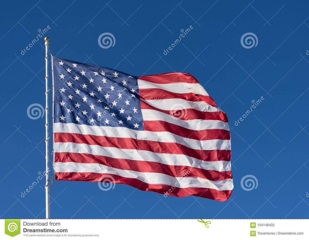 cd3f4331e57 Royalty-Free Stock Photo. The stars and stripes of the American flag  against a deep blue sky.