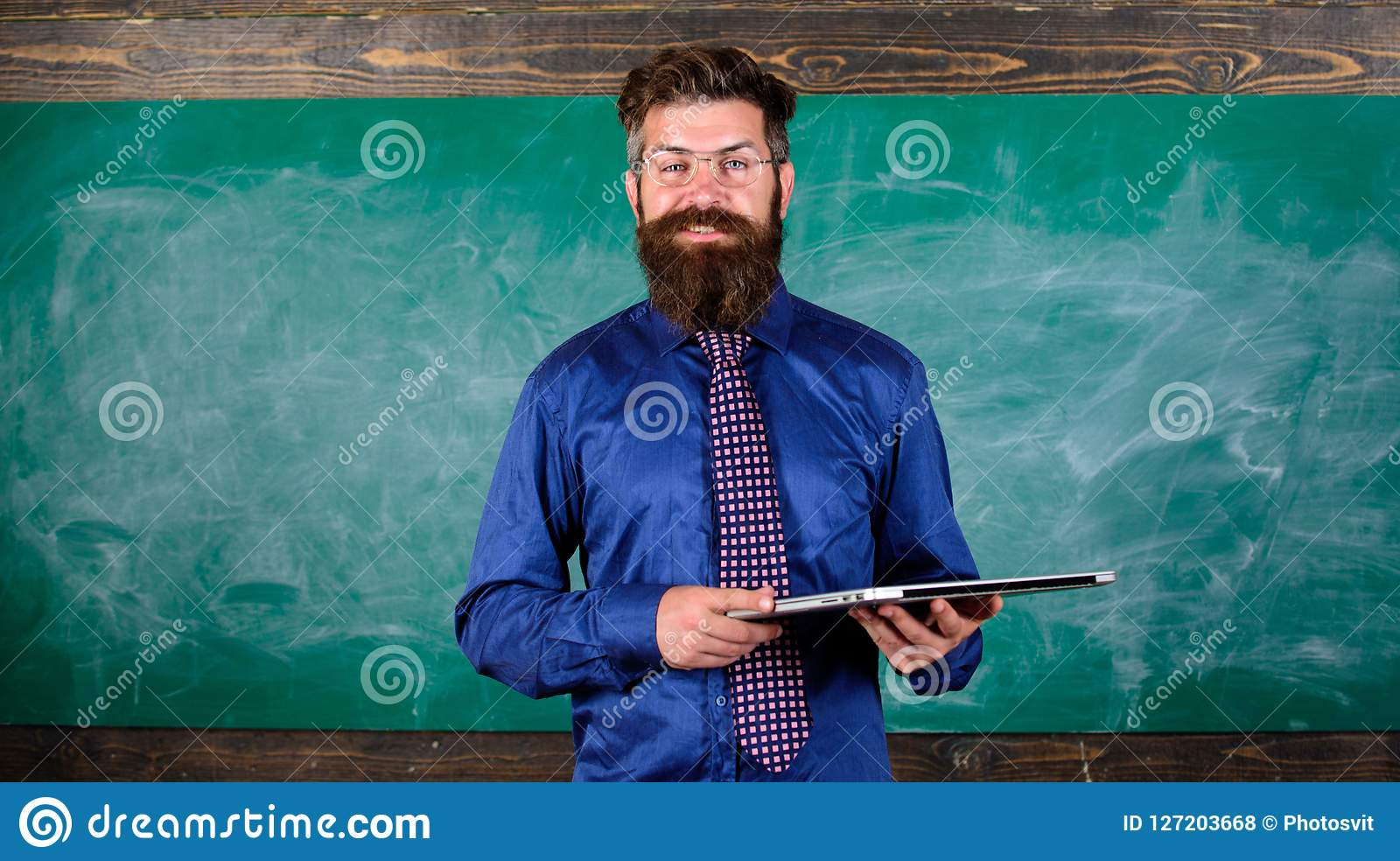 Start lesson. Teacher bearded man with modern laptop chalkboard background. Modern technology education. Hipster teacher
