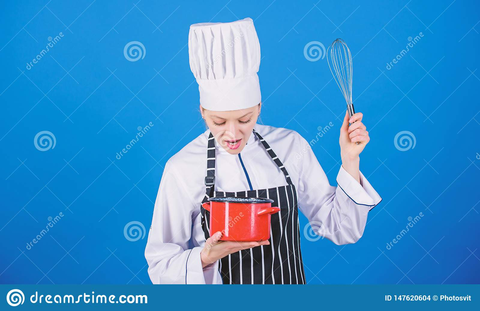 Start slowly whisking whipping or beating cream. Whipping cream tips and tricks. Use hand whisk. Woman professional chef