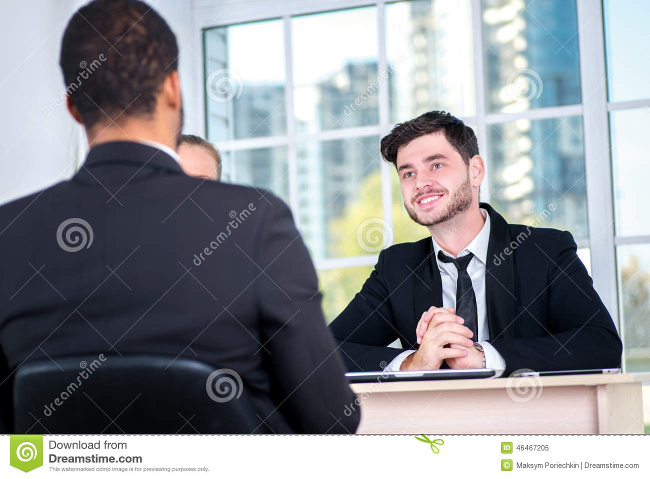 Starting a business meeting. Three successful business people si