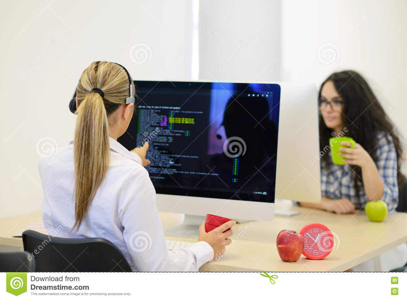 Startup business, young woman as software developer working on computer at modern office