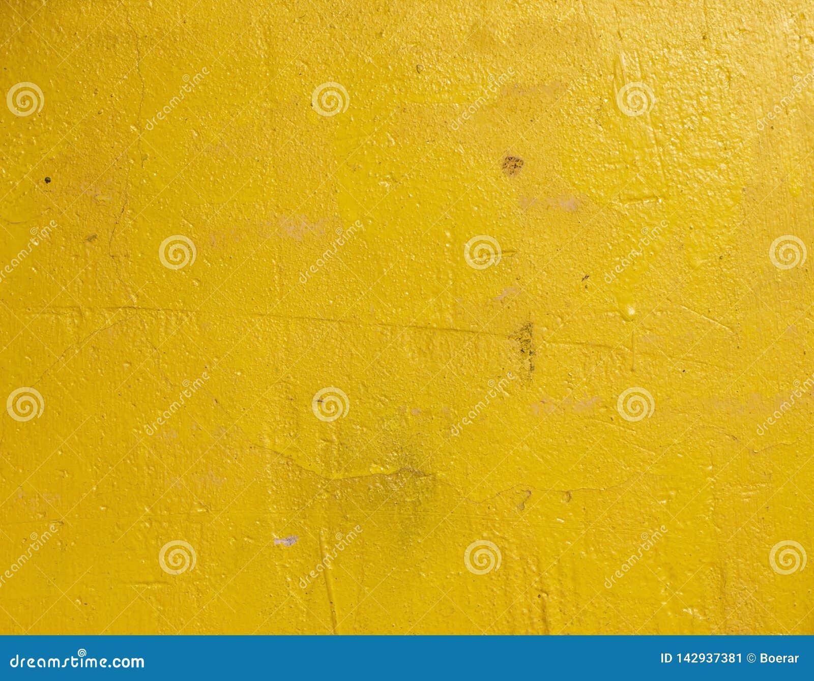 Stary grunge pękający rocznika cementu, betonu foremki tekstury jasnożółty tło i