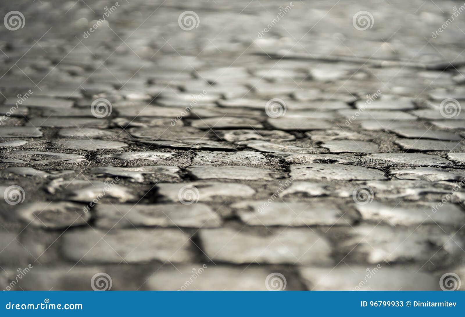 Stary rzymski kamienny bruk w śródmieściu Rzym, Włochy Czerwiec 20