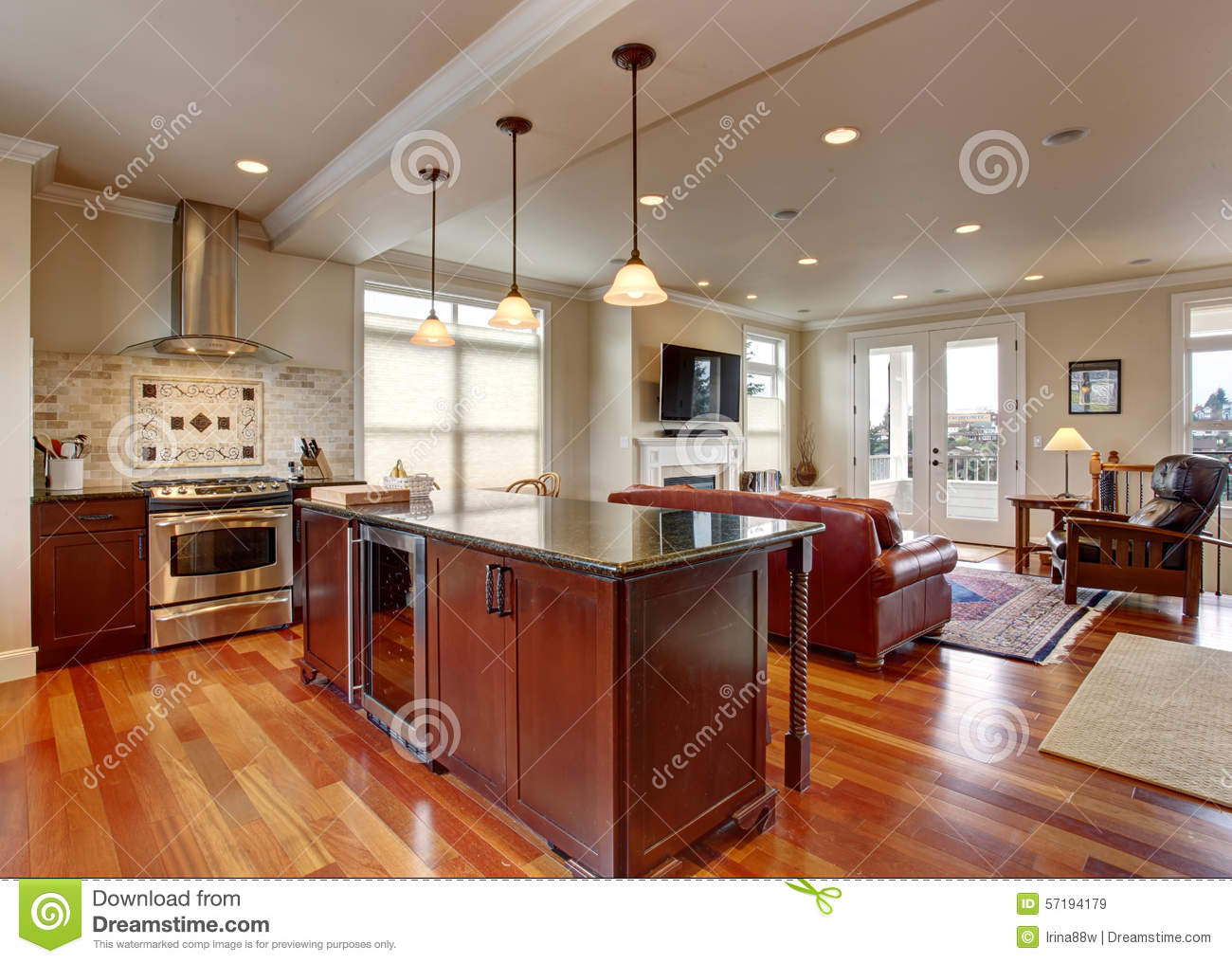 State Of The Art Kitchen With Deep Stained Cabinets, And Stainless Steel  Fridge.