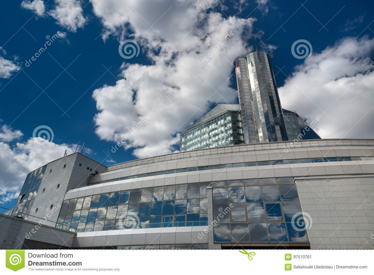 State Institution `National Library Of Belarus`, Futuristic Back View With Reflections Of Blue Sky And White Clouds. One Of The M