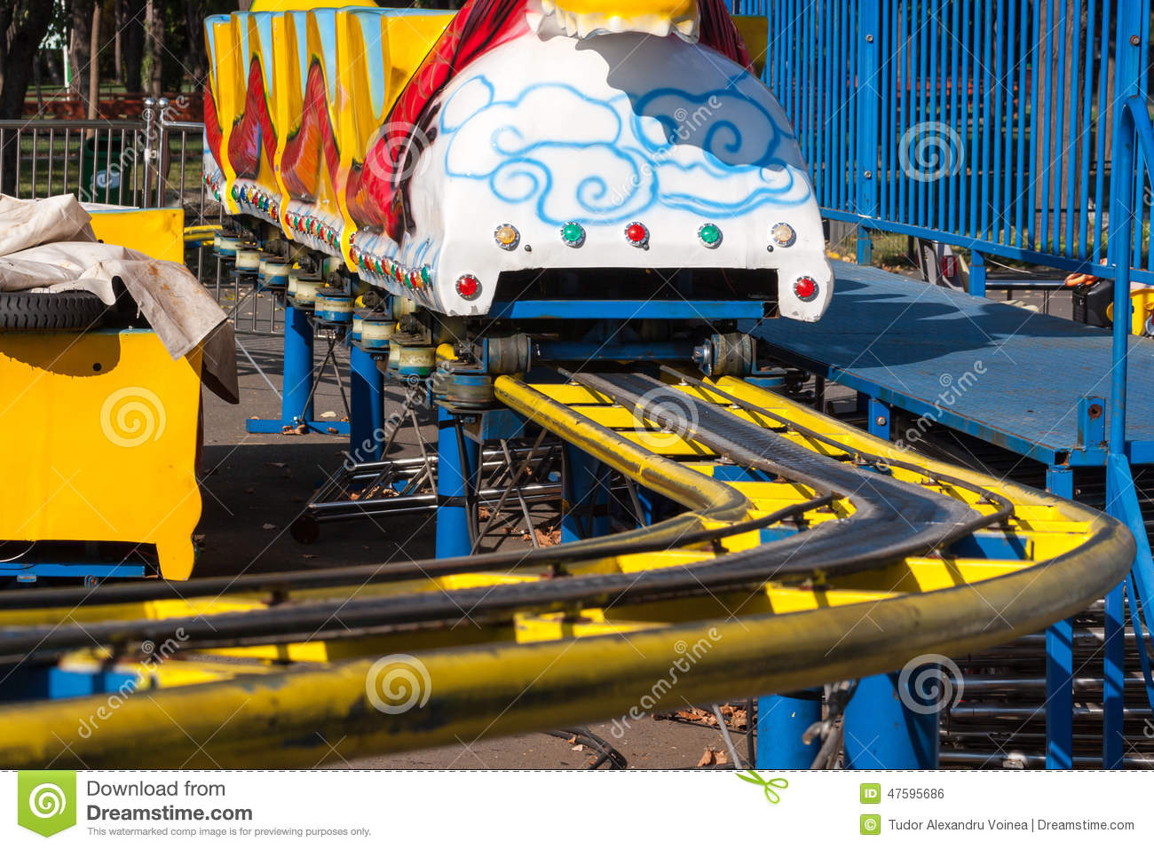 Stationary kids roller coaster with yellow rails.