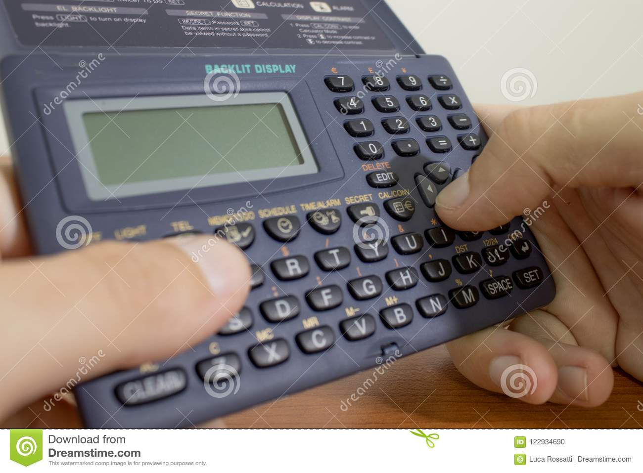 Stationery, Student Is Doing Math Using A Calculator Stock Photo