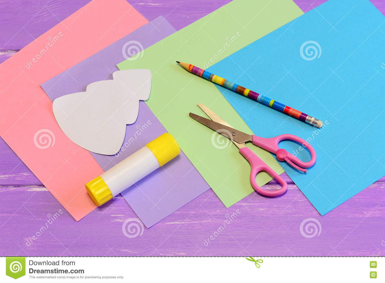 stationery to create a christmas greeting card from colored paper scissors glue stick