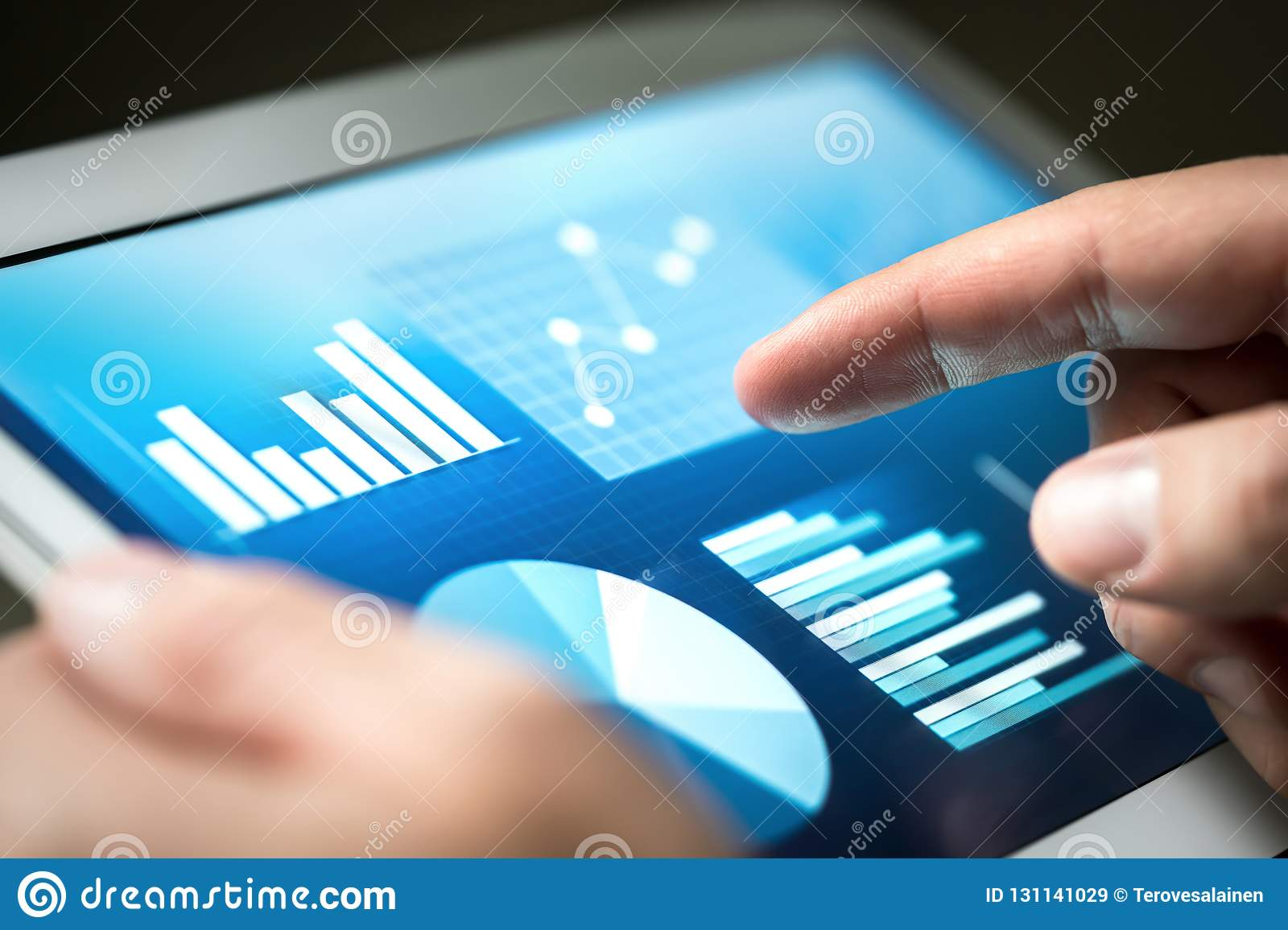 Statistics, graphs, trends and growth on tablet screen. Financia management and development with technology in business.