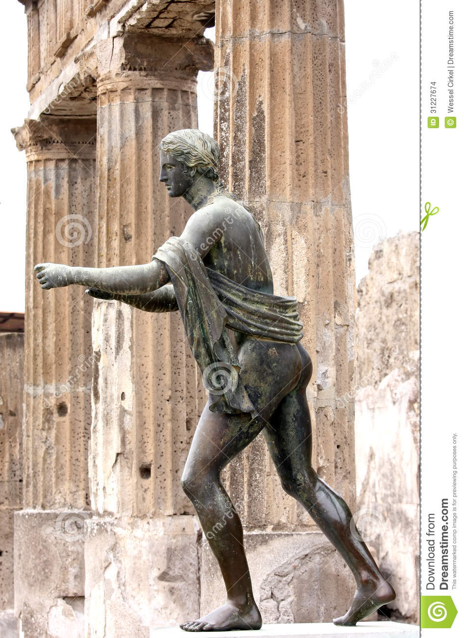 Statue Of Apollo In The Ruins Of Pompei, Italy Stock ...