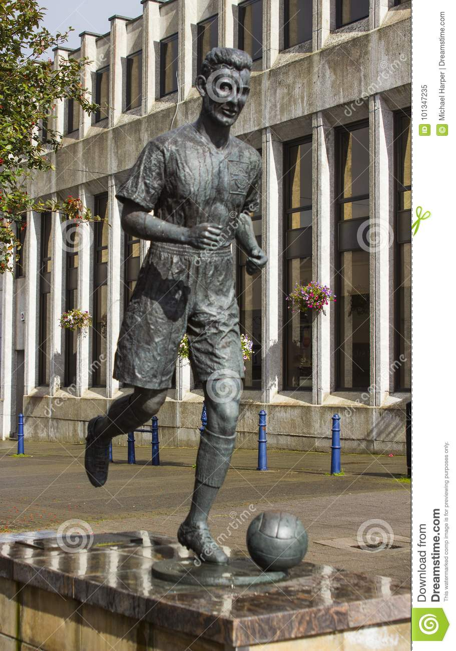 The statue of Bertie Peacock international footballer and manager of Northern Ireland in the town square in Coleraine.