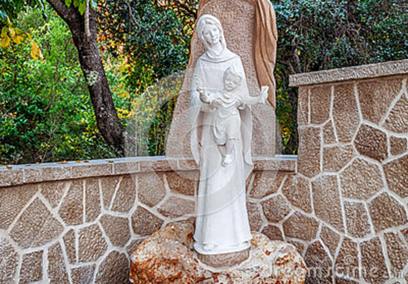 Statue Of The Blessed Virgin Mary With Baby Jesus In Rock Garden In  Medjugorje