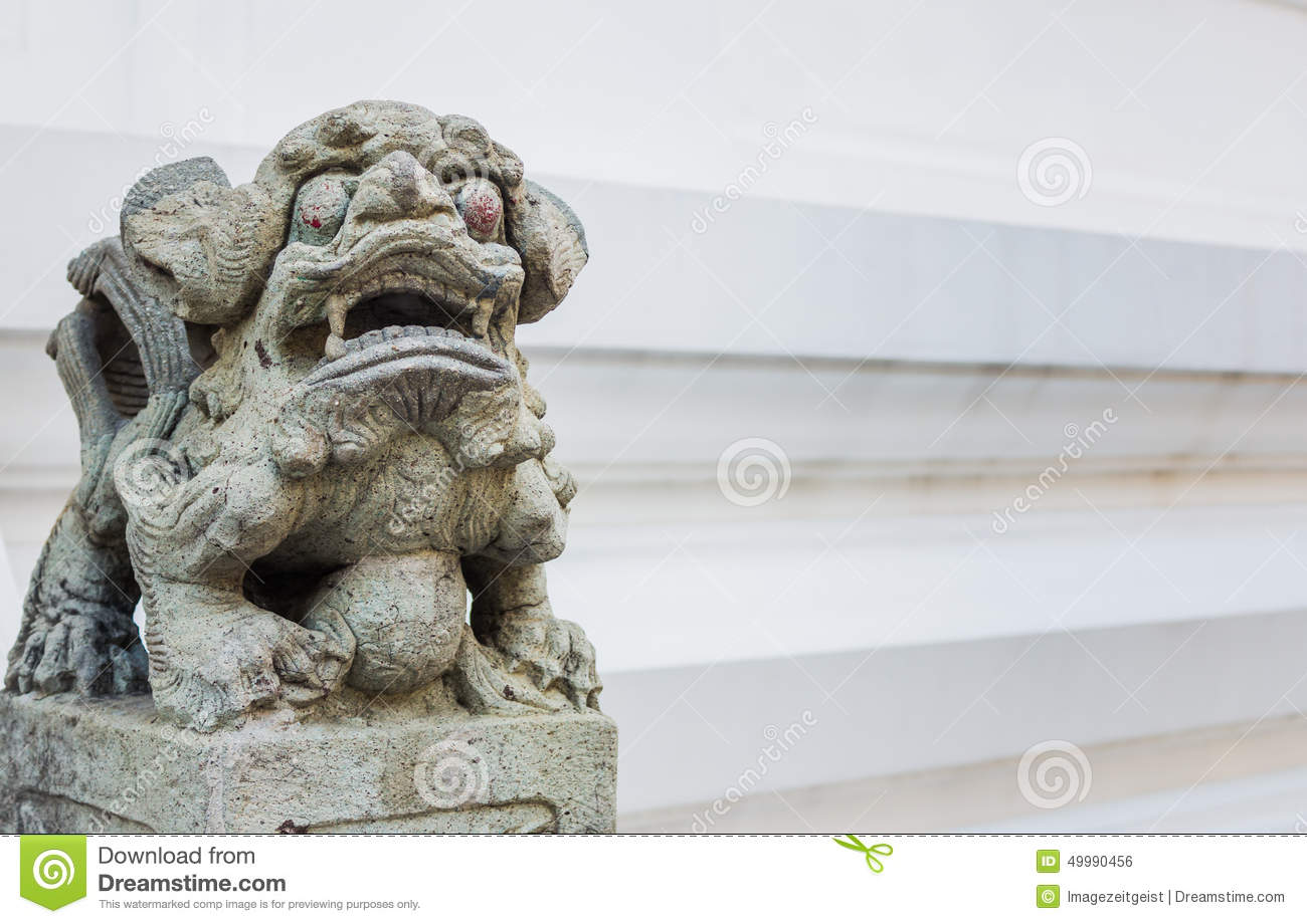 A statue of a Chinese guardian lion