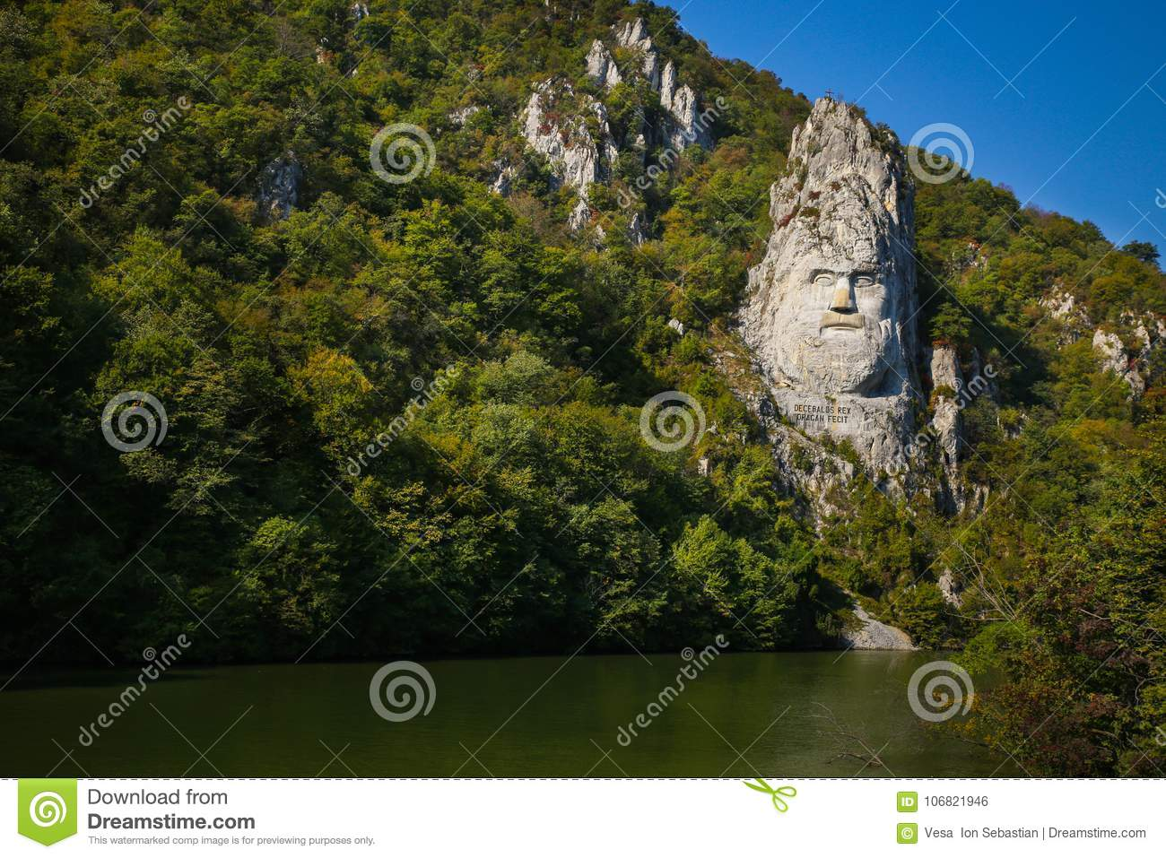 The statue of Decebal carved in the mountain. Decebal`s head carved in rock, Iron Gates Natural Park