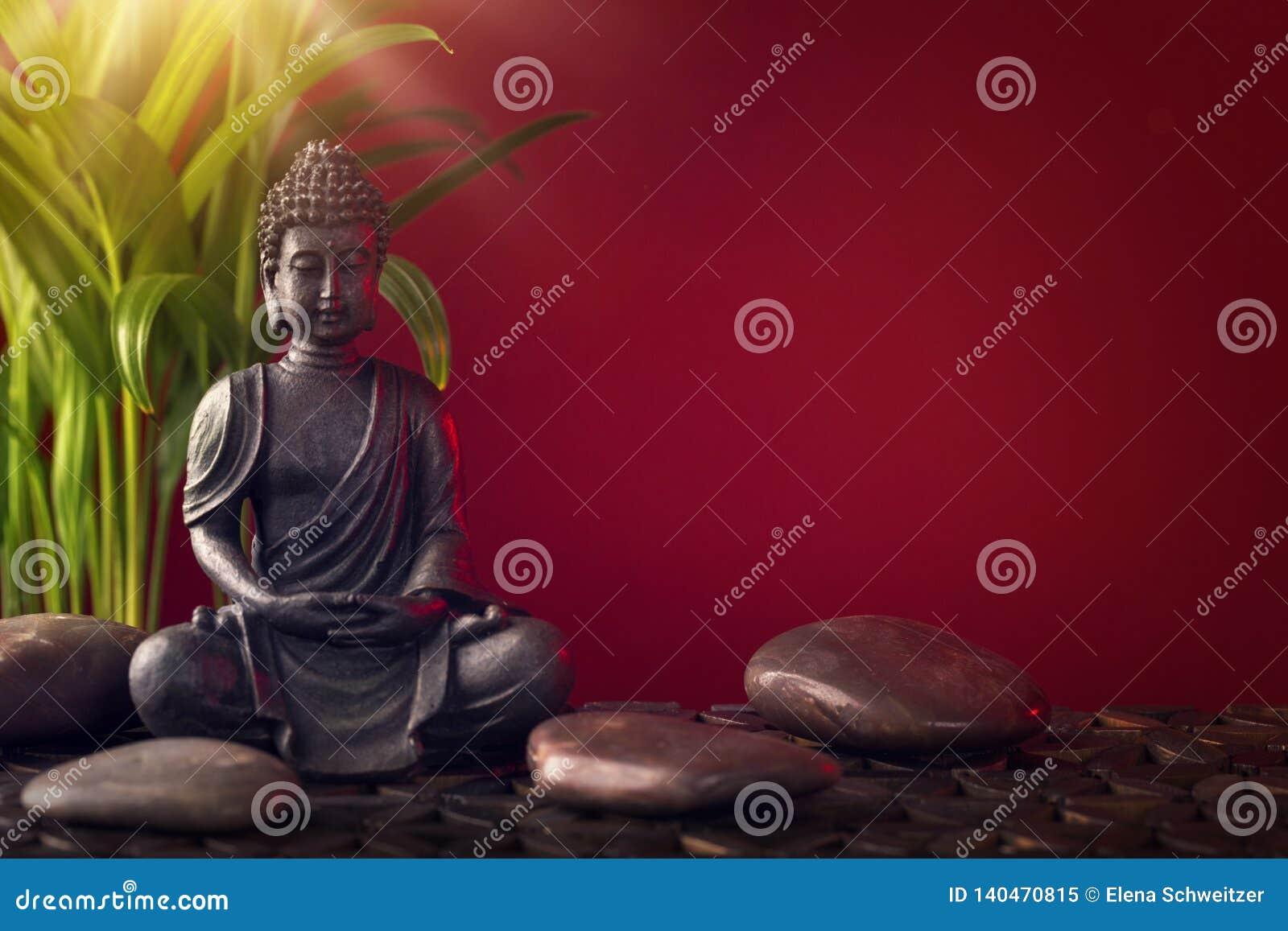 Statue et pierres de Bouddha
