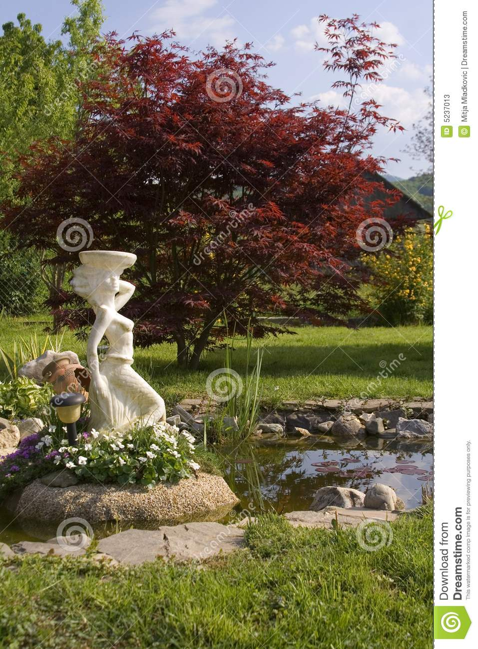 Stsatuette For Outdoor Ponds: Statue In Garden Pond Stock Image. Image Of Blooming