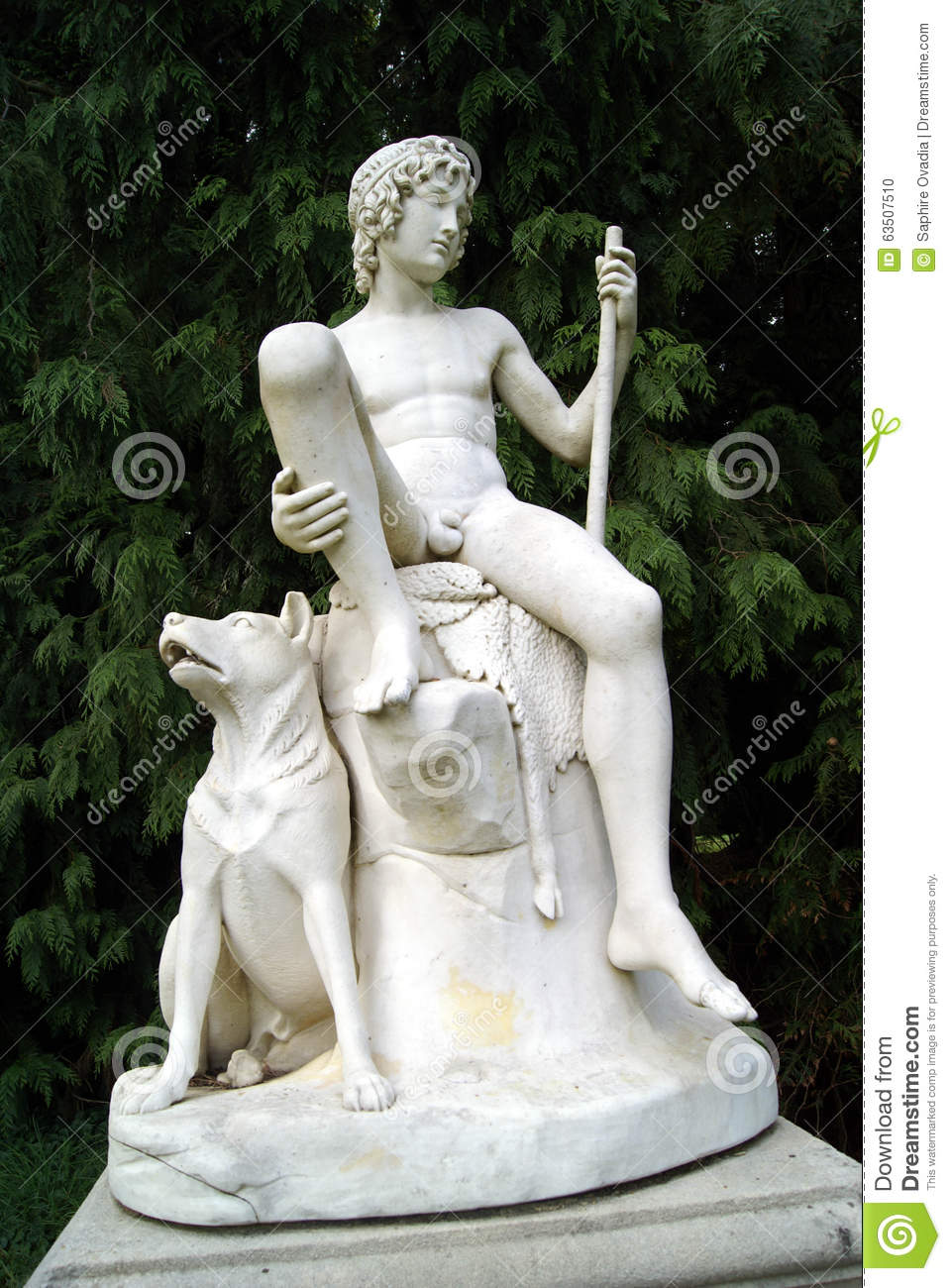 statue of a shepherd boy and his dog stock photo