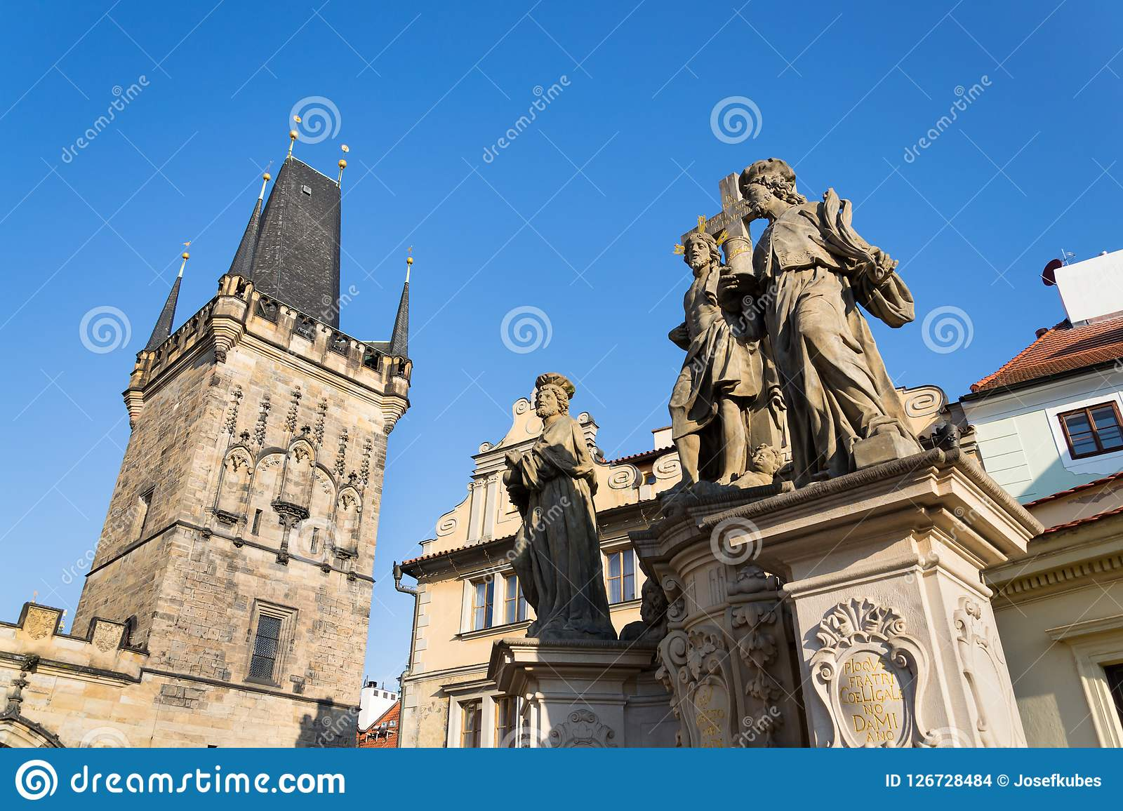 Statue of Holy Savior with Saints Cosmas and Damian detail on Charles Bridge, Prague, Czech Republic. Statue of Holy Savior with Saints Cosmas and Damian detail Stock Images