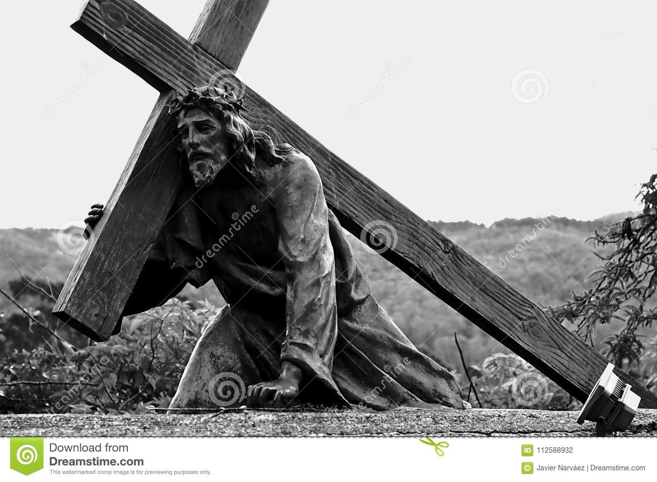 Statue Of Jesus Christ Falling With The Cross Stock Photo