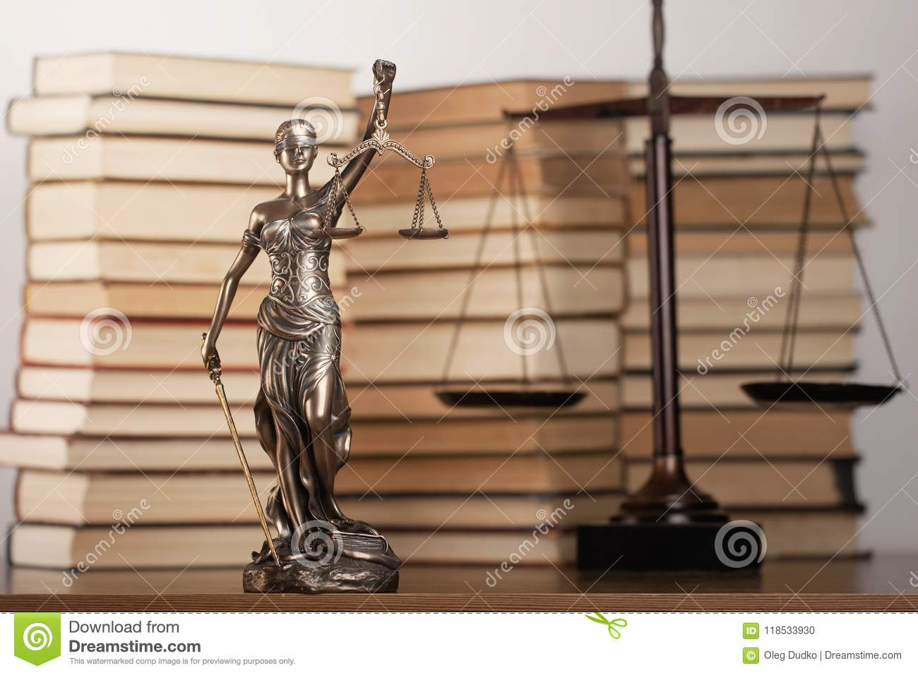 Statue of justice and book