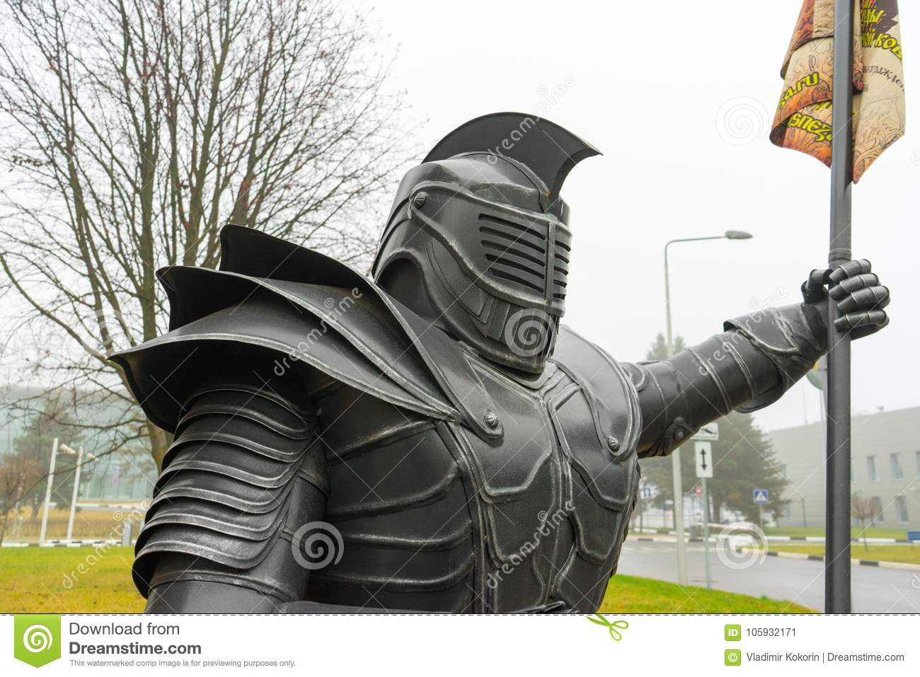 The statue of the knight. The figure of a man in metal armor.
