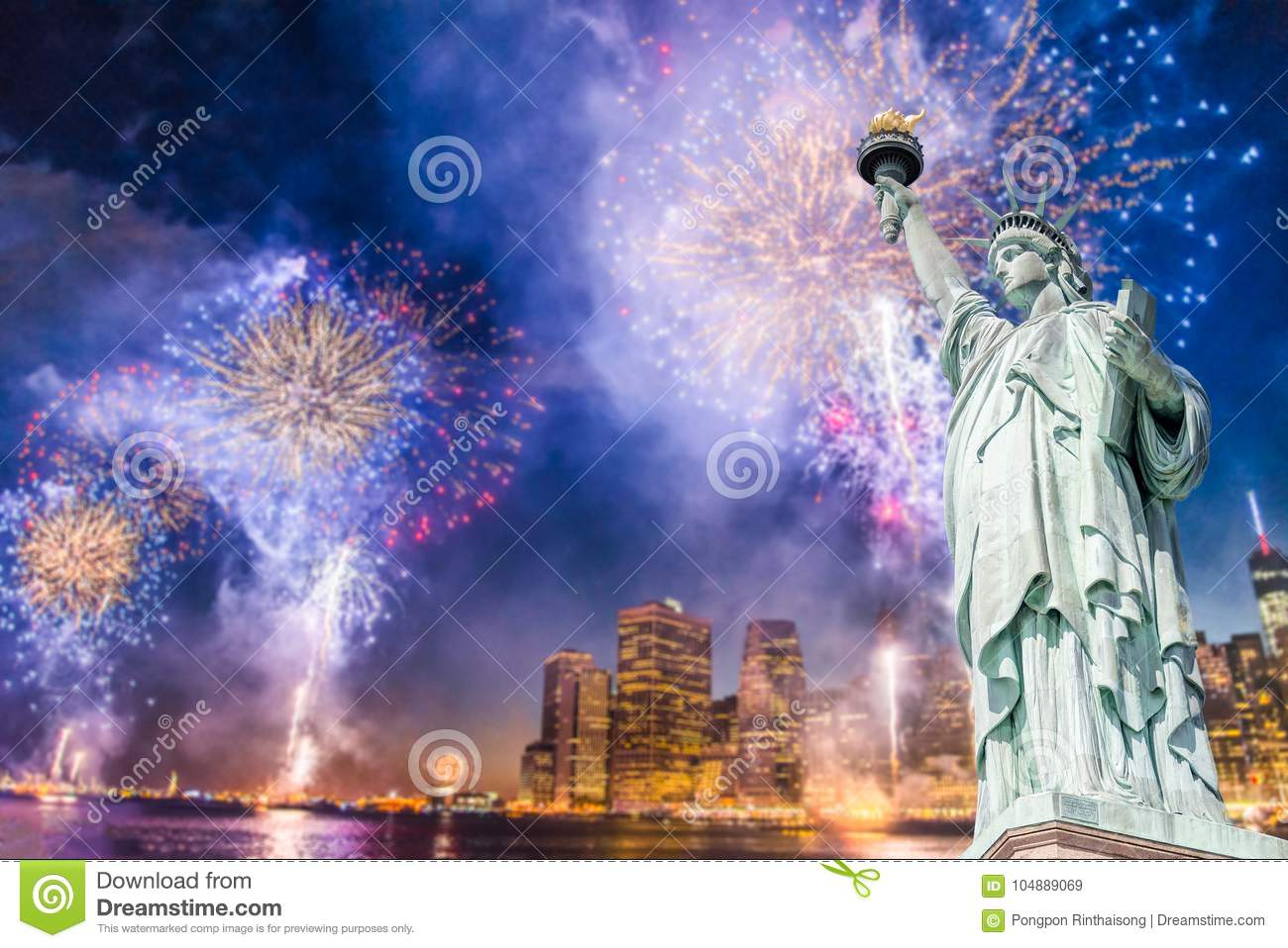 the statue of liberty with blurred background of cityscape with beautiful fireworks at night manhattan new york city usa