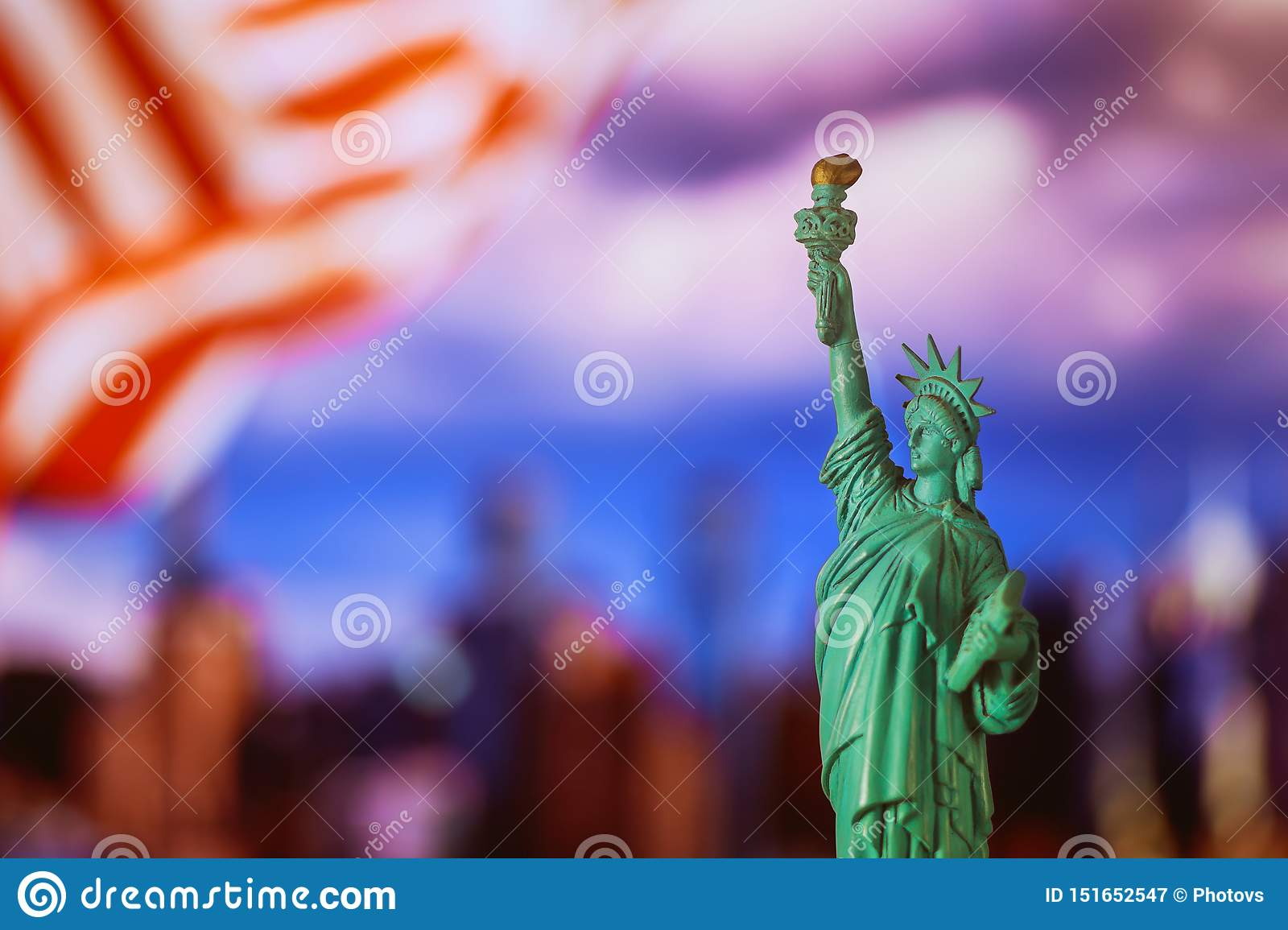 Statue of Liberty with flag of the United States of America New York City