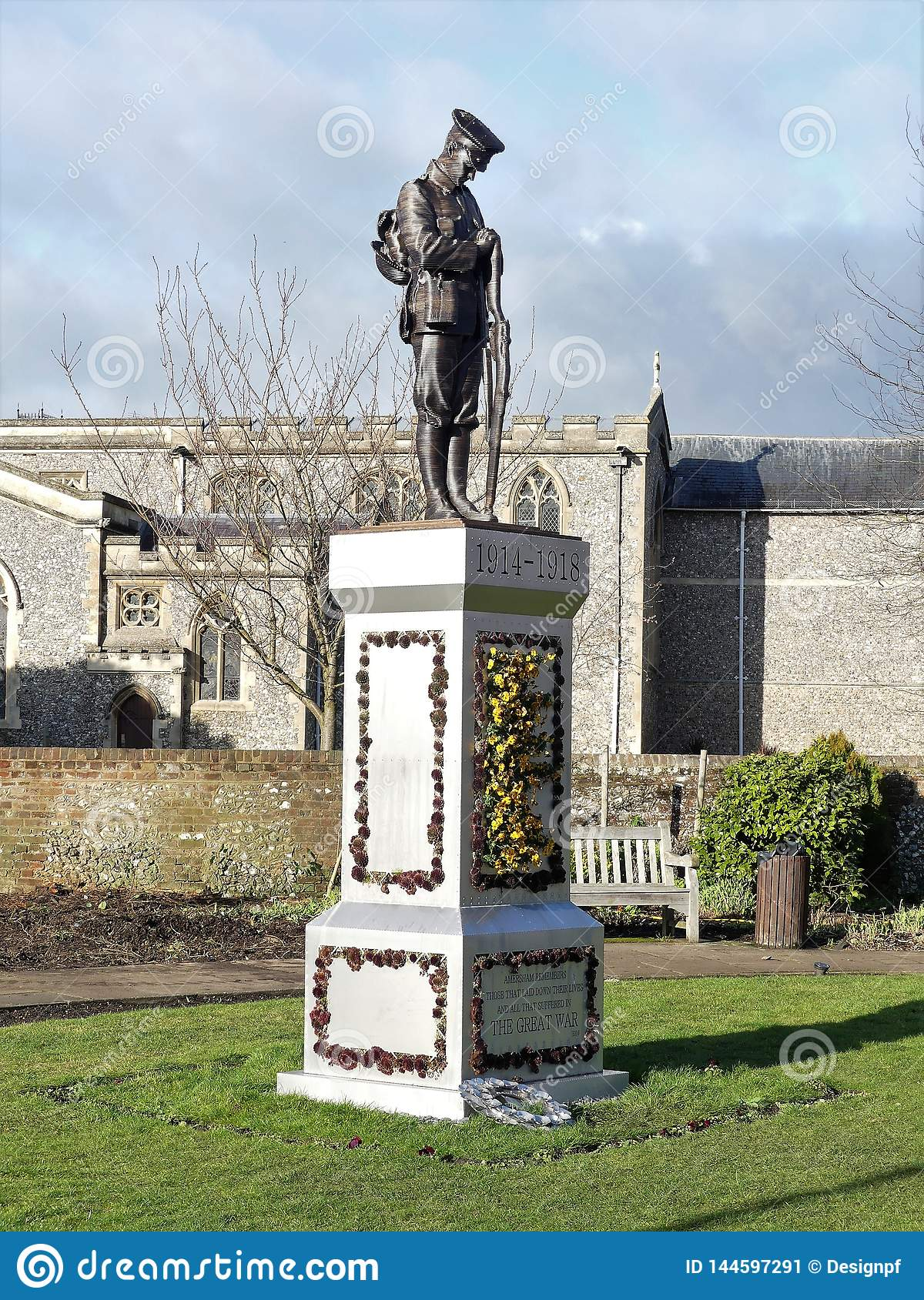 Statue of a lone soldier on a plinth in The Memorial Gardens in Old Amersham, Buckinghamshire, UK