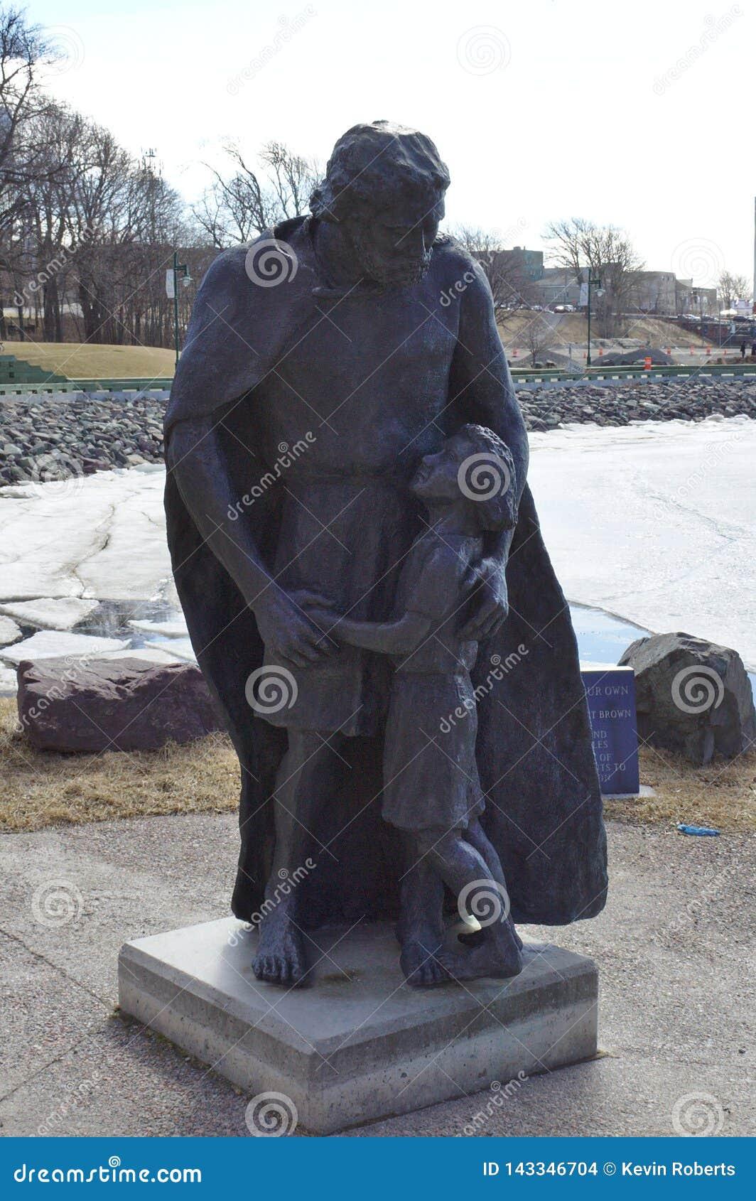 Statue of man & girl