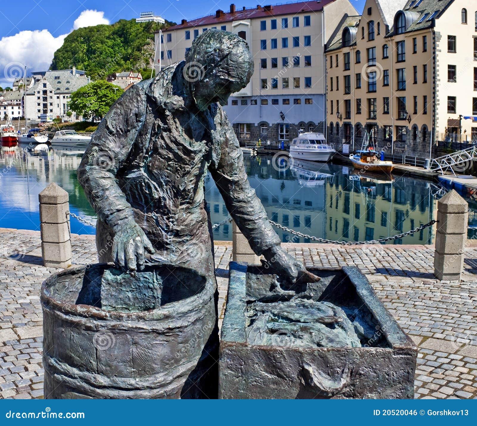 statue of seasonal fishworker in alesund norway royalty