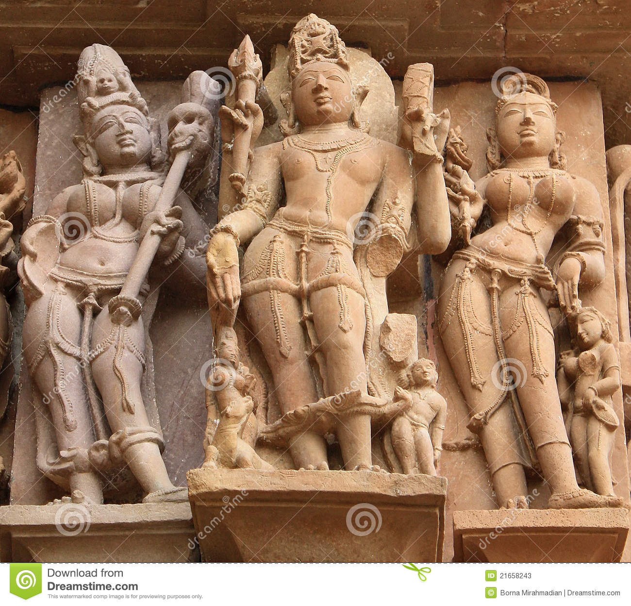 Three statues on the facade of a temple in Khajuraho, India.